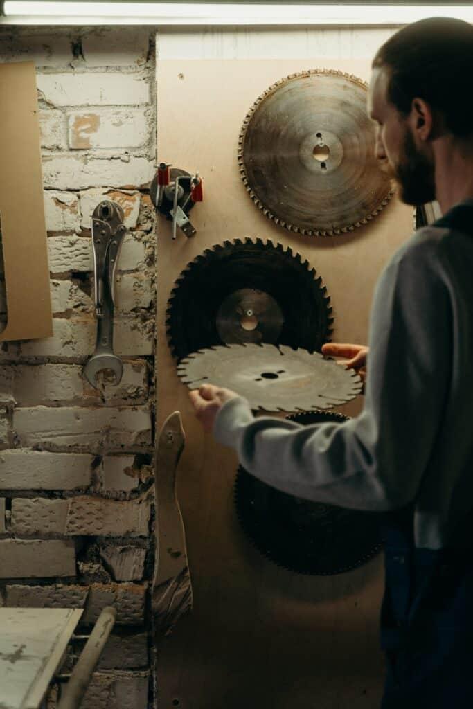 Man stowing circular saw blade.